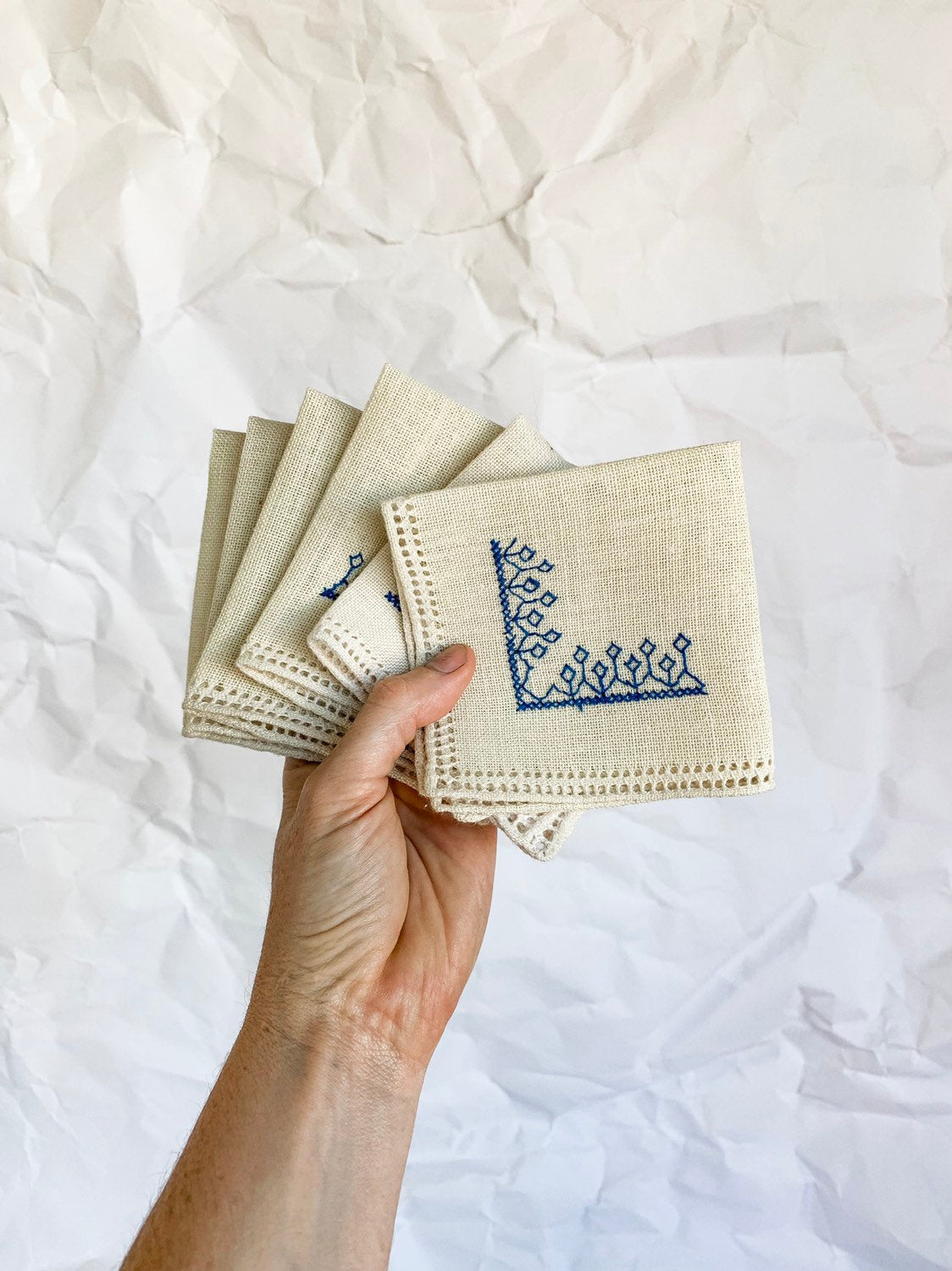 Set of Six Cream Woven Cocktail Napkins With Blue Embroidery