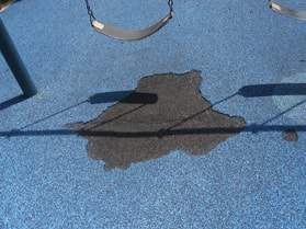 Maintaining a poured in place rubber surface