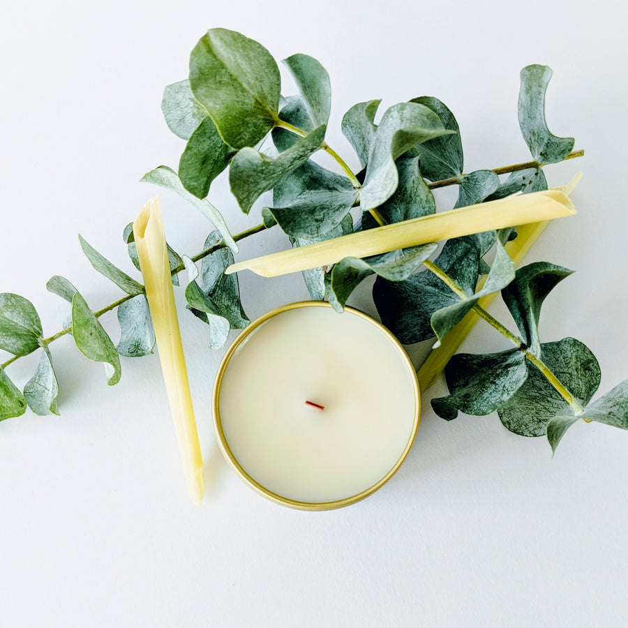 Gold tin candles and eucalyptus