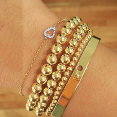 bead bracelets in gold, silver, rose