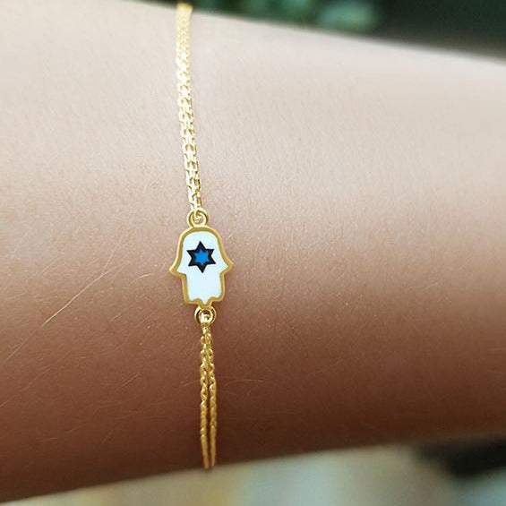 yellow gold hamsa and star bracelet