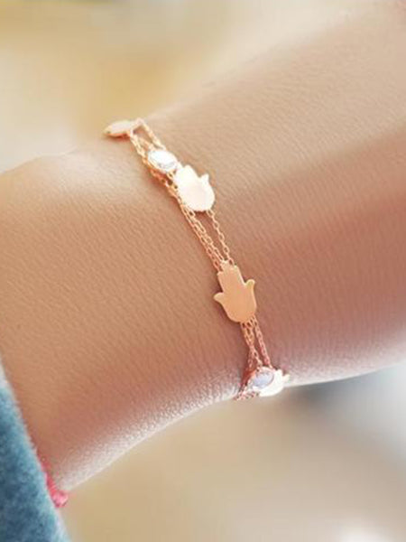 TRIPLE ROSE GOLD HAMSA BRACELET