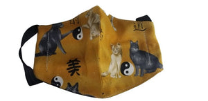 Asian cat mask in yellow hues