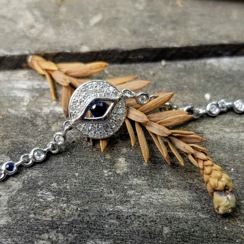 diamond and gold evil eye bracelet