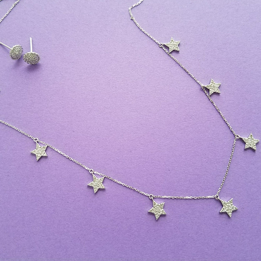 star charm necklace in gold and diamonds