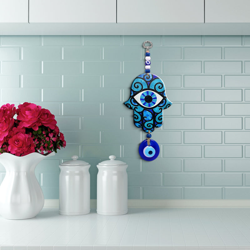 hamsa in kitchen blue tile wall