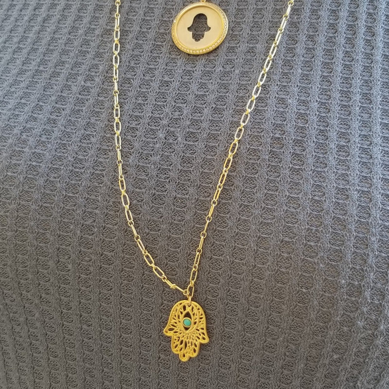 hamsa necklace in gold on paper clip chain