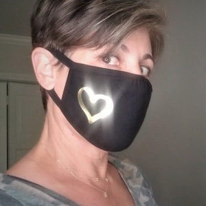golden heart on person mask