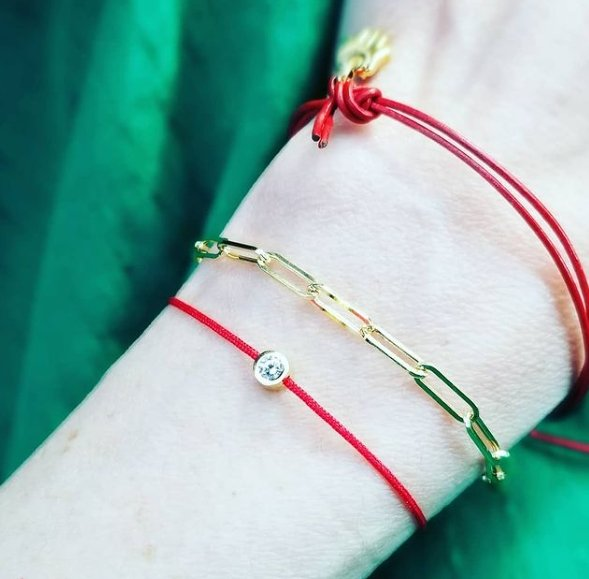 red string bracelet with stone