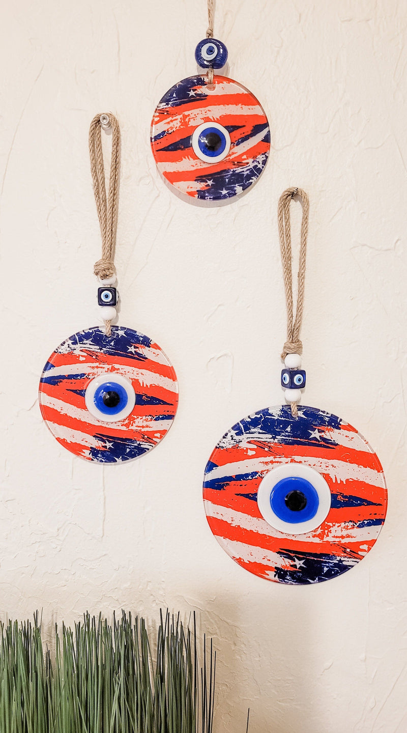 trio wall art flag and evil eye