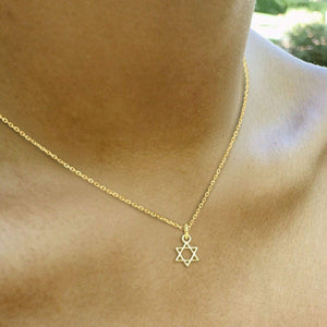 yellow gold tiny jewish star necklace
