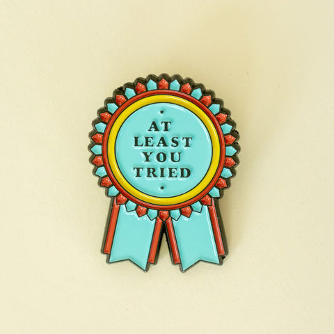 Enamel Winner Pin in blue/ orange