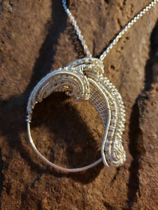 A large circlular swirl necklace
