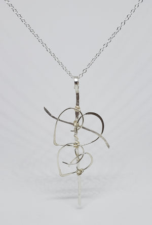 Entwinded hearts cross necklace
