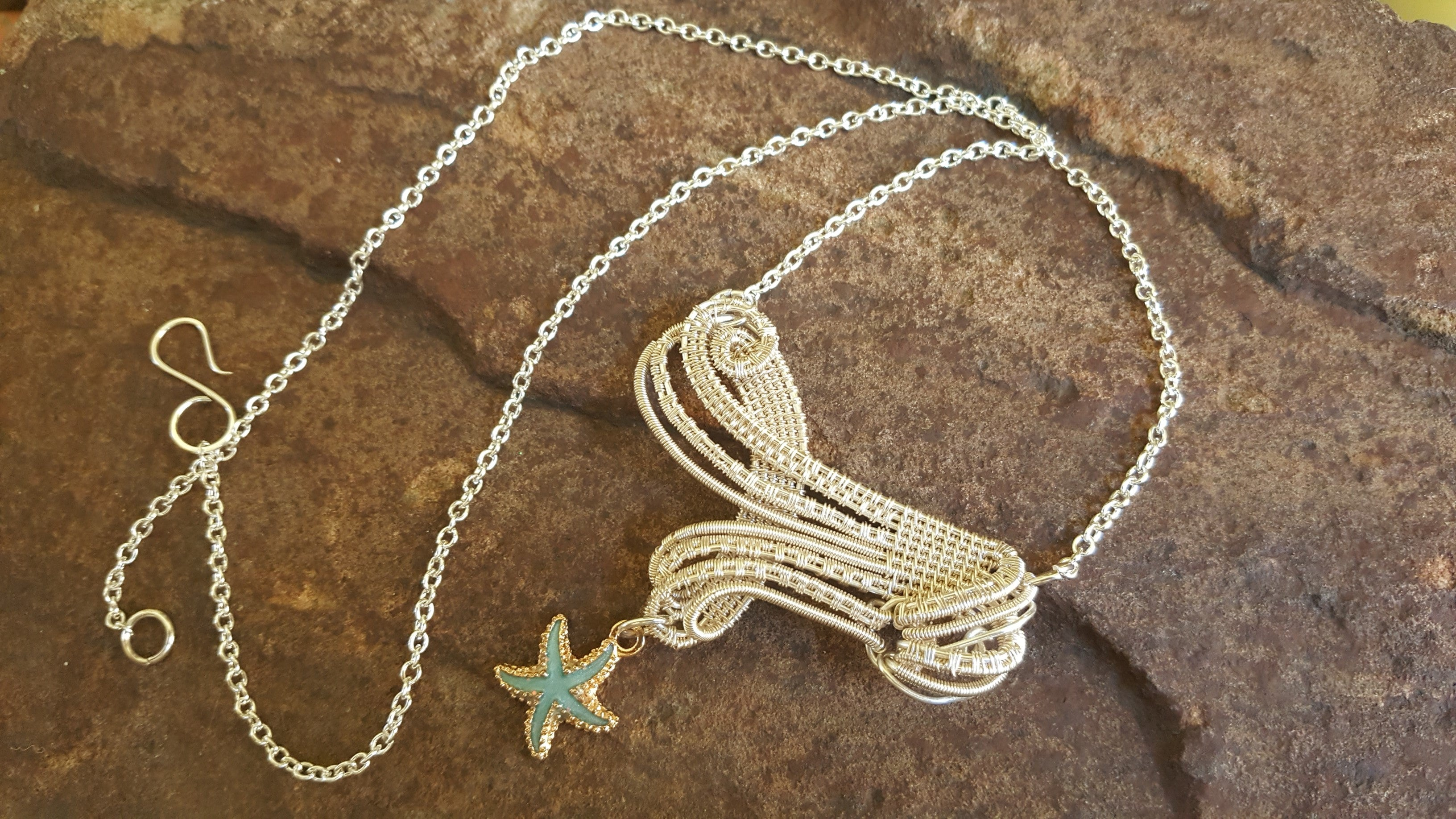 A wonderfully woven silver Stream and Tide necklace
