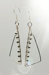 Long silver triangular beaded earrings