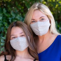 Mom and daughter wearing matching BooginHead gray face masks