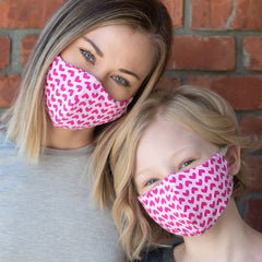 Mom and daughter wearing matching BooginHead pink masks