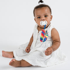 Baby using BooginHead pacifier clip