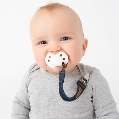 Baby using BooginHead luxe pacifier clip
