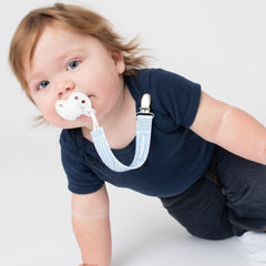 Baby using PaciGrip silicone blue bubbles