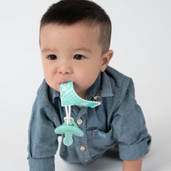Baby using PaciGrip silicone green bubbles
