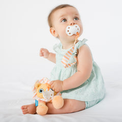 Baby using BooginHead PaciPal & PaciGrip pacifier clips