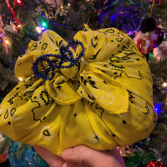 Furoshiki wrapped gift, blue pipe cleaner ribbon