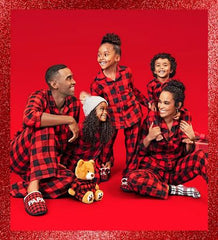 Family in matching family pajamas in buffalo check from Target