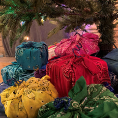 Furoshiki wrapped gifts under tree