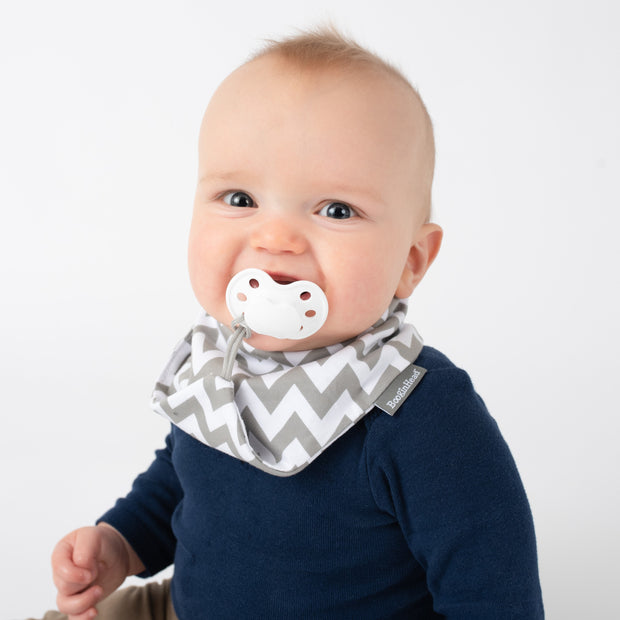 baby boy  wearing BoobinHead Bandana Teether Bib with pacifier loop holder and adjustable size snap closure