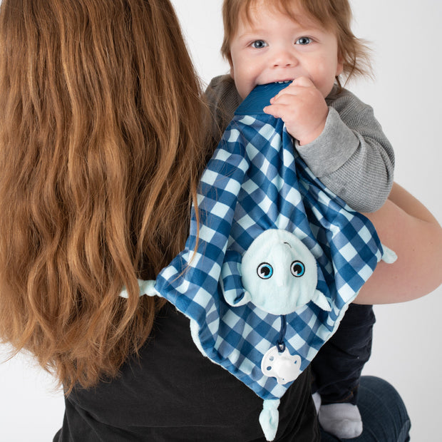 BooginHead Plush PaciPal Teether Blanket, our friendly Lucky the Elephant design. Very soft with blue and white geometric design. Pacifier loop, textured blue silicone teething piece for sore gums, soothing knots for texture. A plush lovey friend.