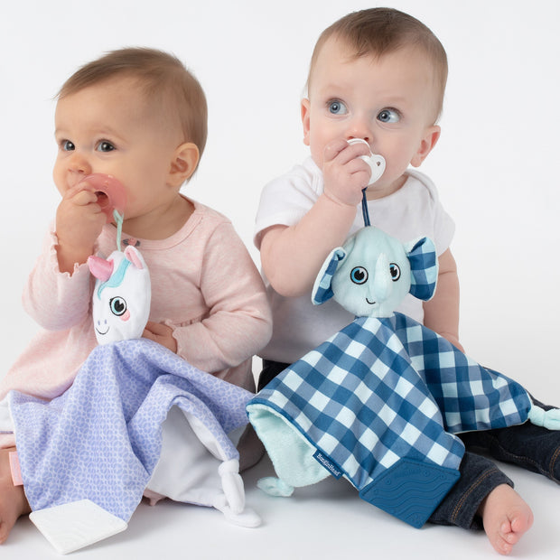 Babies each with their favorite lovey, Dreamer the Unicorn and Lucky the Elephant, both keeping track of their pacifiers with the handy loop. Purple and white unicorn and blue and white elephant.
