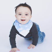 Baby boy wearing BooginHead Bandana Bib in  Blue Sky with soft blue and white cloud designs