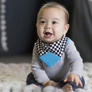 Baby boy wearing BooginHead Bandana Teether Bib in Checkerboard for drool protection vans design