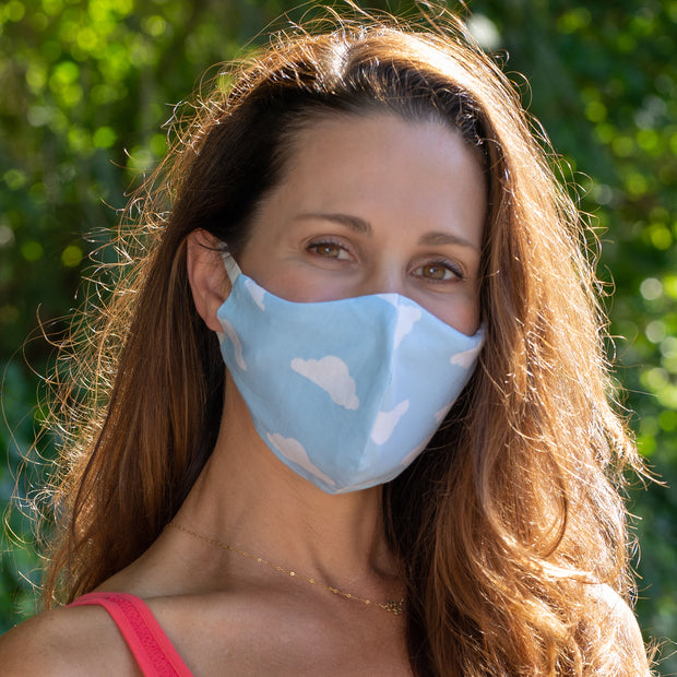 Woman wearing BooginHead Face Mask in Blue Sky