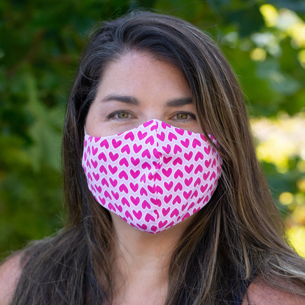Woman wearing BooginHead Face Mask in Pink Hearts