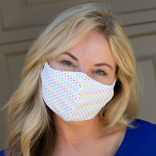Woman wearing BooginHead Adjustable Adult Face Masks in Rdot, rainbow design.