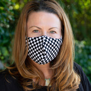 Woman wearing BooginHead Face Mask in checkerboard design, B&W Check