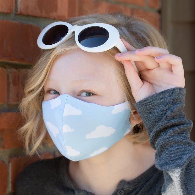 Teen wearing BooginHead Adjustable Face Mask in Blue Sky soft cotton