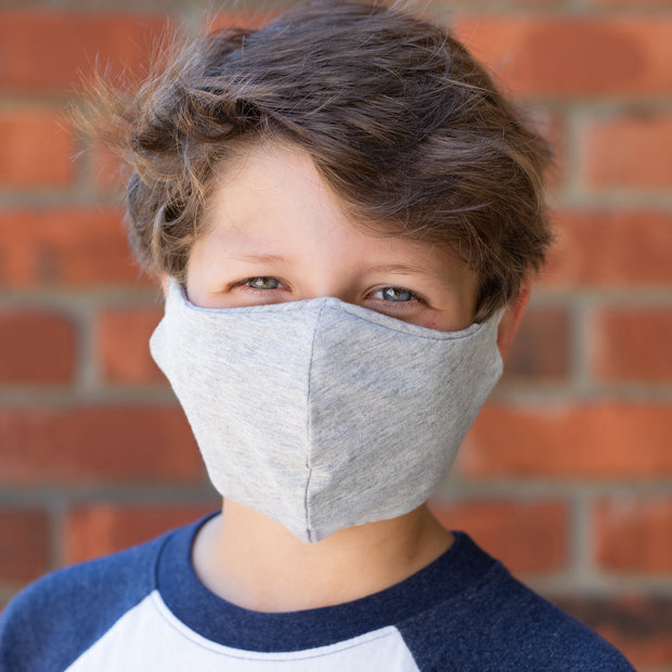 Teen wearing BooginHead Adjustable Face Mask in heather gray soft cotton