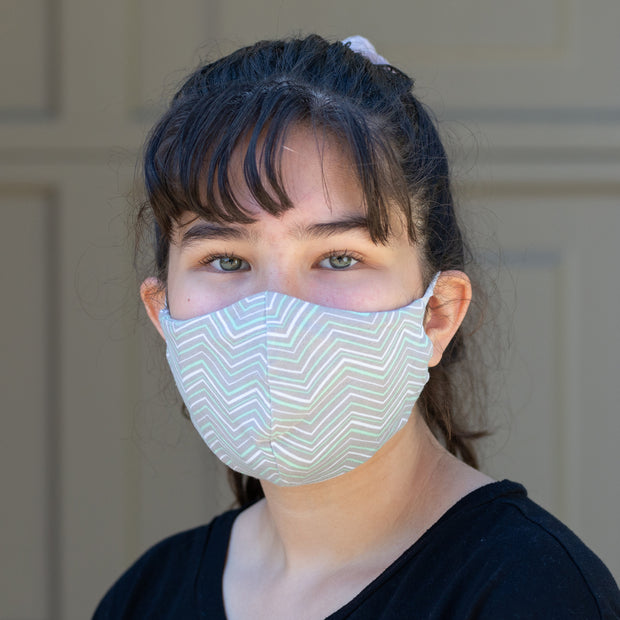 Teen wearing BooginHead Adjustable Face Mask in Minty ZigZag soft cotton