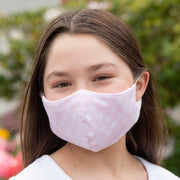Girl wearing BooginHead Youth Face Mask in Pink Star