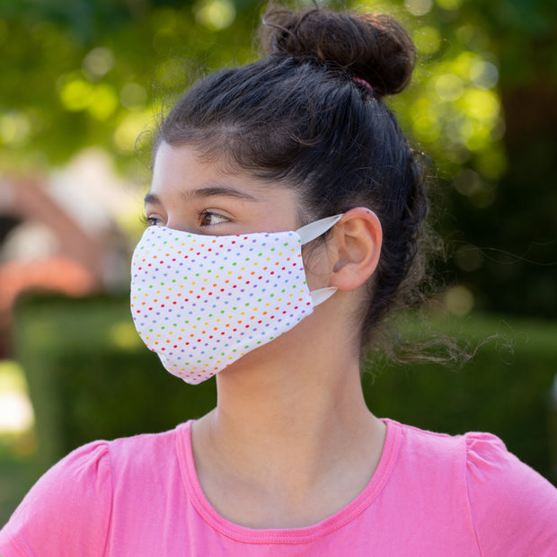 Teen wearing BooginHead Adjustable Face Mask in Rdot, rainbow design