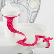 BooginHead SippiGrip Silicone in hot pink, strap to hold a sippy cup, bottle or toy, with soothing teething bumps.