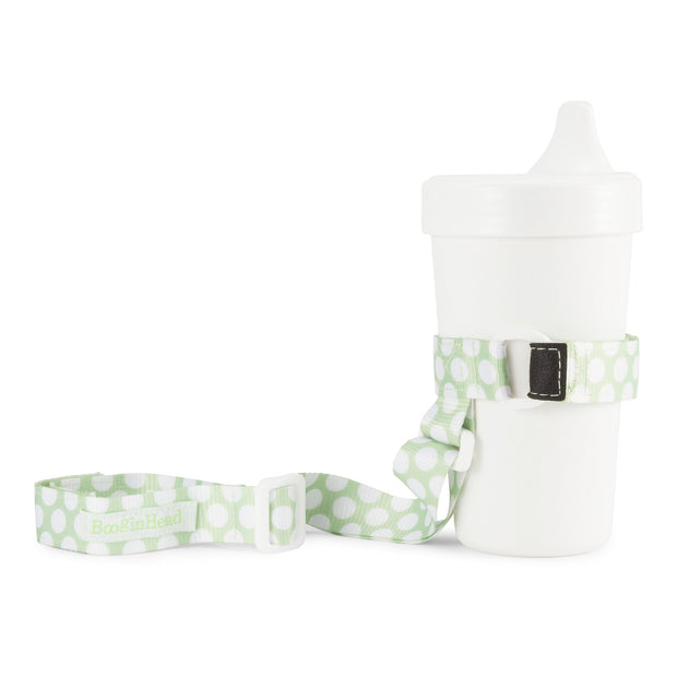 BooginHead SippiGrip in Delicate Dot Green with adjustable straps. Keep bottles and sippy cups clean and off the floor with the cup holders. Attaches toddler sippy cups, bottles or toys to a highchair or stroller.