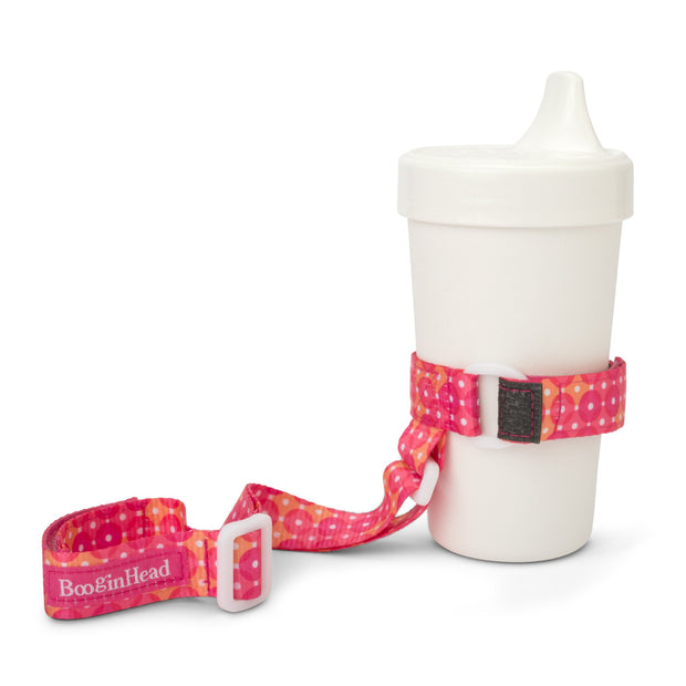 BooginHead SippiGrip in Dottie keeps sippy cup from falling on the ground getting dirty or lost. Keeps baby items off the ground and clean. Bright pink with orange and white polka dot design