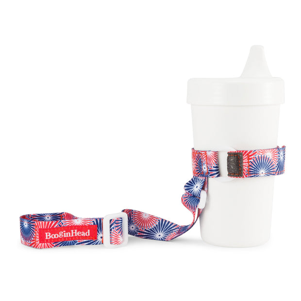 BooginHead SippiGrip in Fireworks, red white and blue patriotic design, keeps sippy cup from falling on the ground getting dirty or lost. Keeps baby items off the ground and clean.