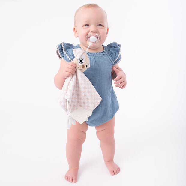 Toddler using the BooginHead Plush PaciPal Teether Blanket, Patches the Puppy. Keeps track of pacifier with attaching loop. Super soft fabric from a woman owned small business. Essential baby gear!