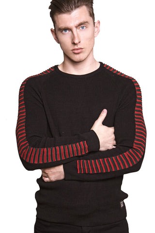 Man Wearing a Black T-shirt with Red Pattern